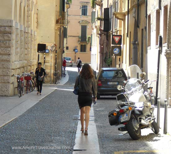 Woman Walking on Verona Street